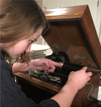Jennifer Haynes mounting a cylinder on the Edison player